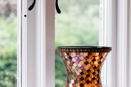 http://Vase%20on%20a%20windowsill%20with%20wood%20window
