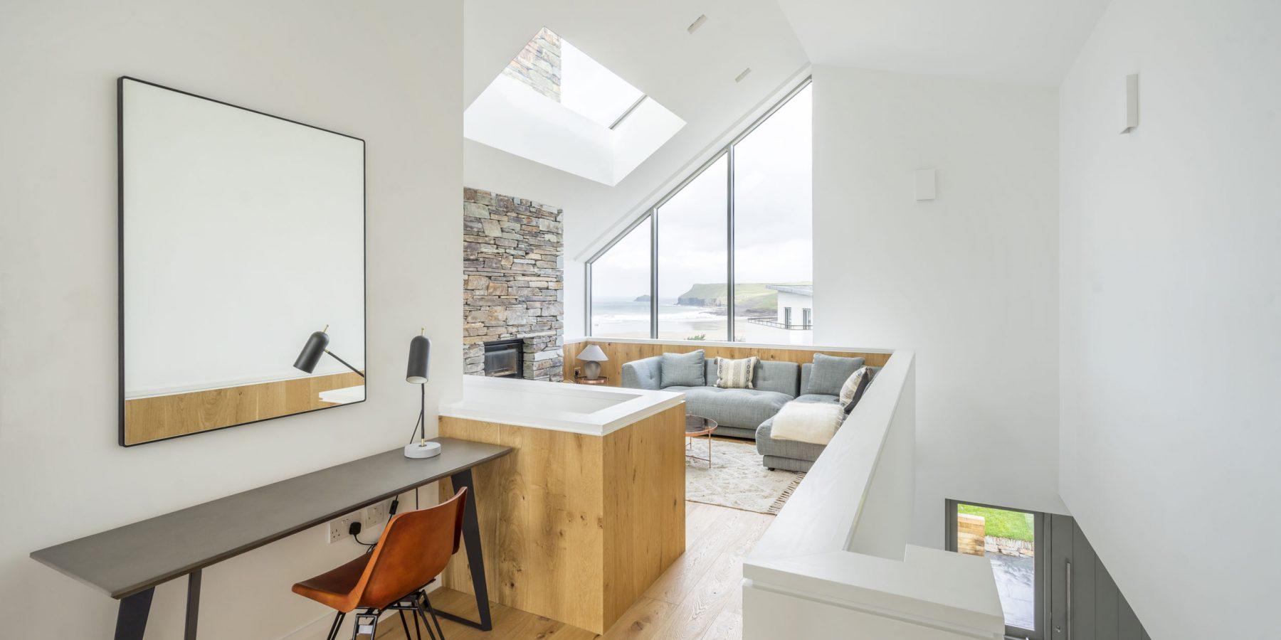 Modern room with big windows and hard wood floor