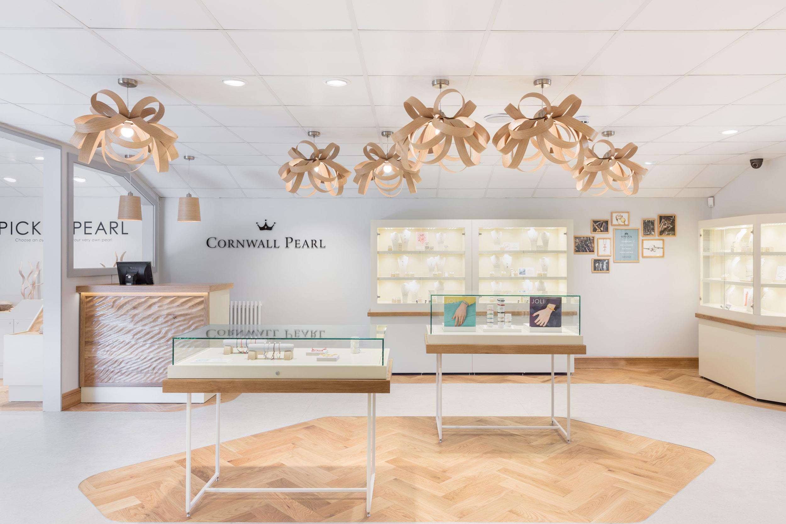 Herringbone wood flooring installation for Cornwall Pearl's retail space