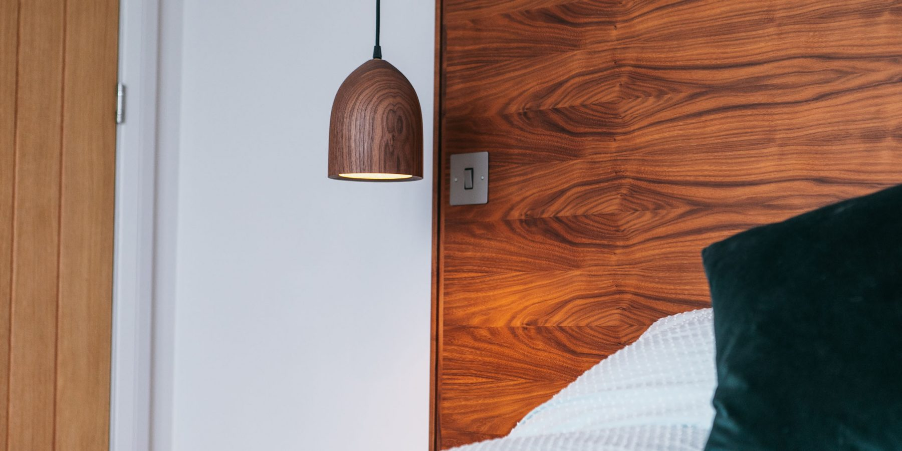Thumbnail of http://Wood%20headboard%20and%20bedside%20lamp