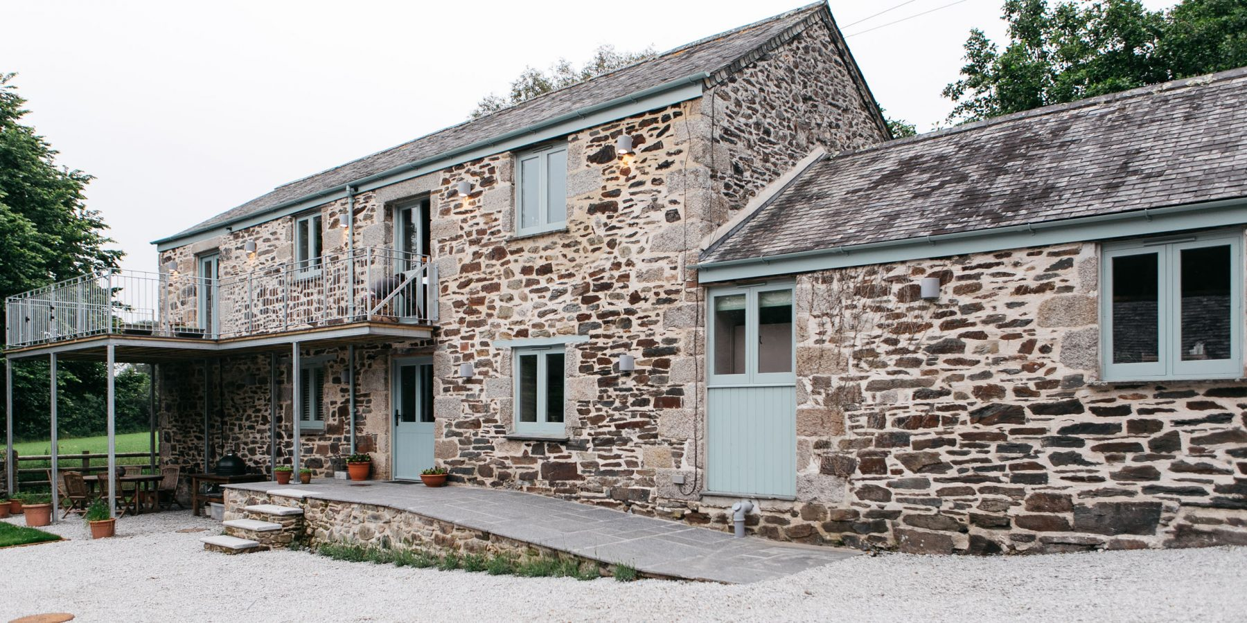 Cornish stone house with blue painted windows and doors