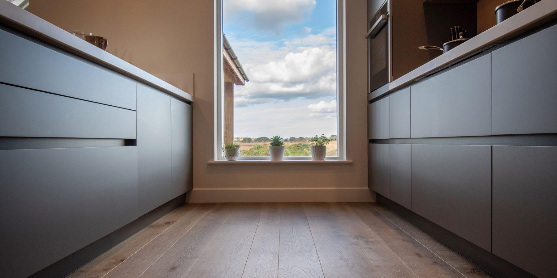 Window in a dark kitchen with a wood floor