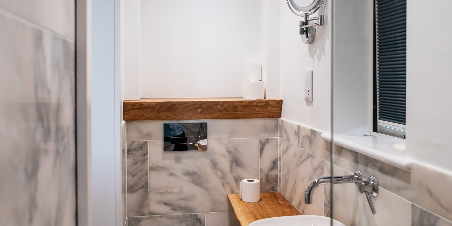 Thumbnail of http://Washroom%20with%20white%20toilet%20and%20basin
