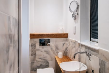 http://Washroom%20with%20white%20toilet%20and%20basin