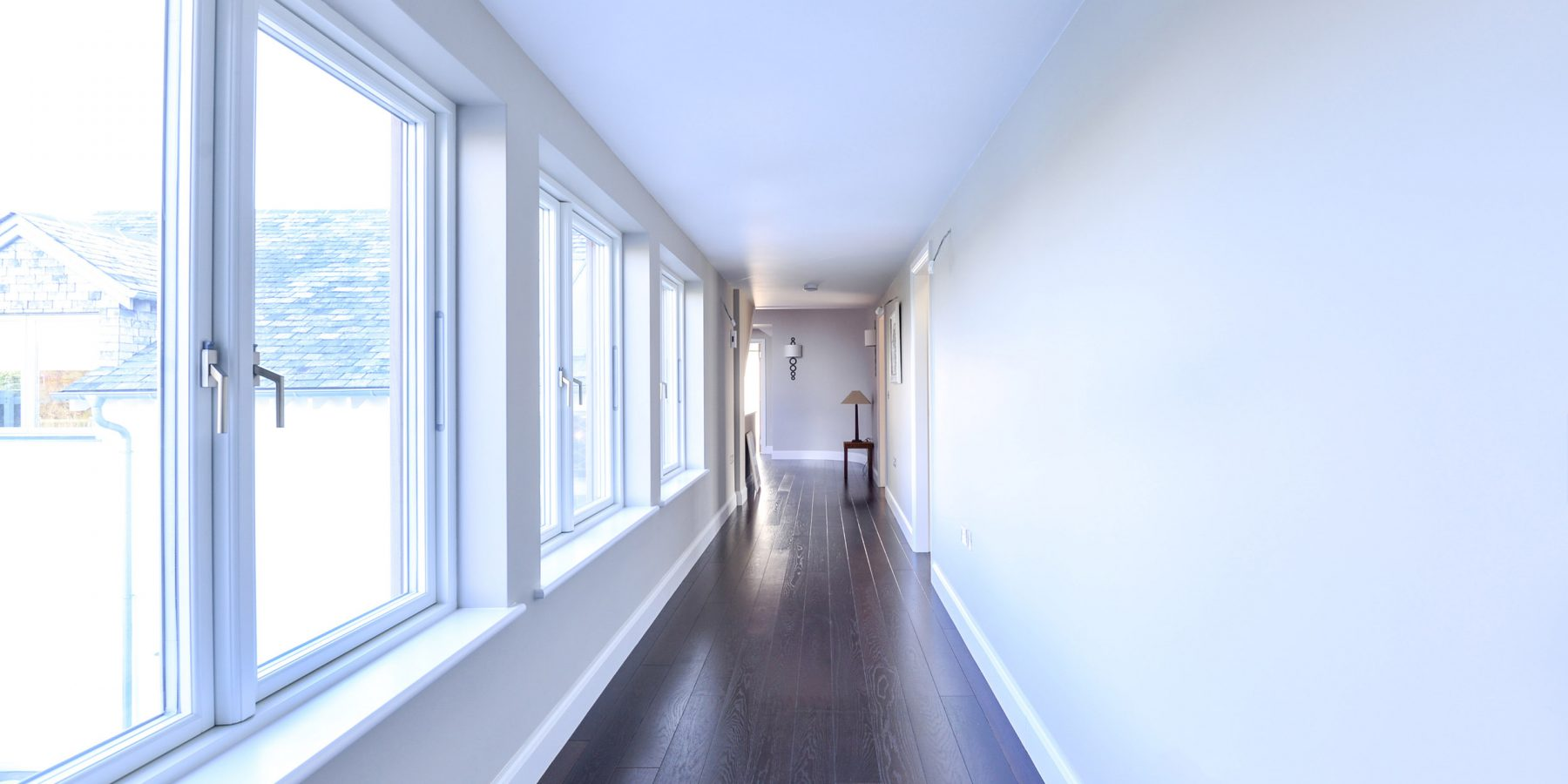 Thumbnail of http://White%20hallway%20with%20windows%20and%20dark%20wood%20floor