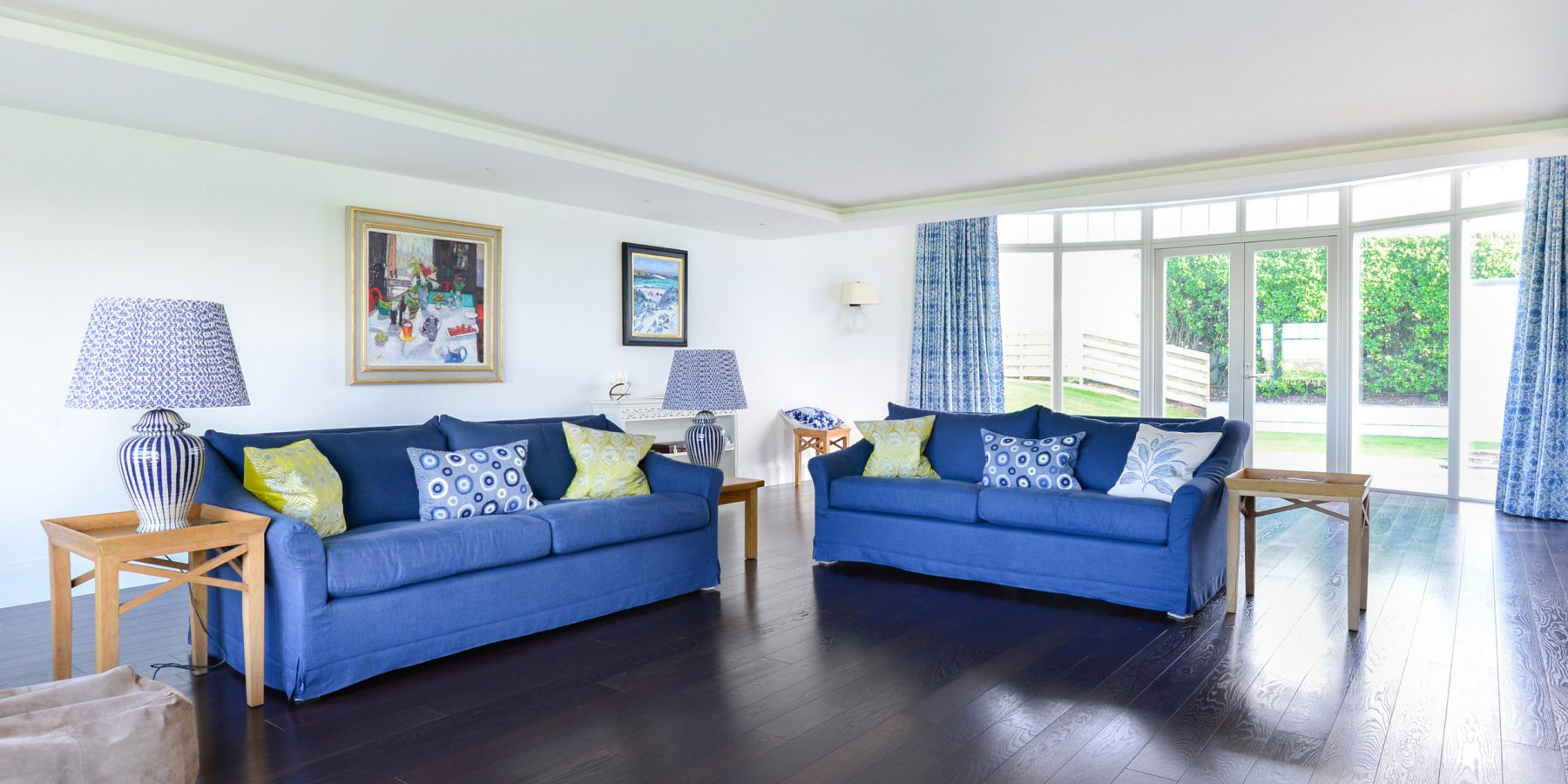 Thumbnail of http://Blue%20sofas%20in%20sitting%20room%20with%20dark%20wood%20floor