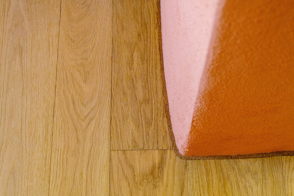 Thumbnail of http://Wood%20floor%20meeting%20a%20pink%20curved%20wall
