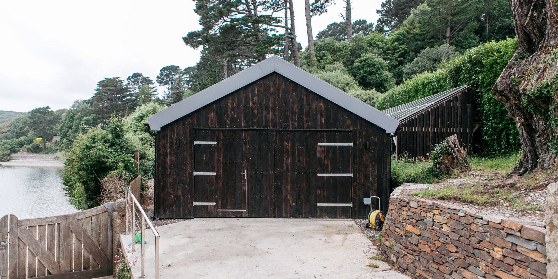 Thumbnail of http://Dark%20wood%20external%20timber%20cladding%20on%20a%20small%20building