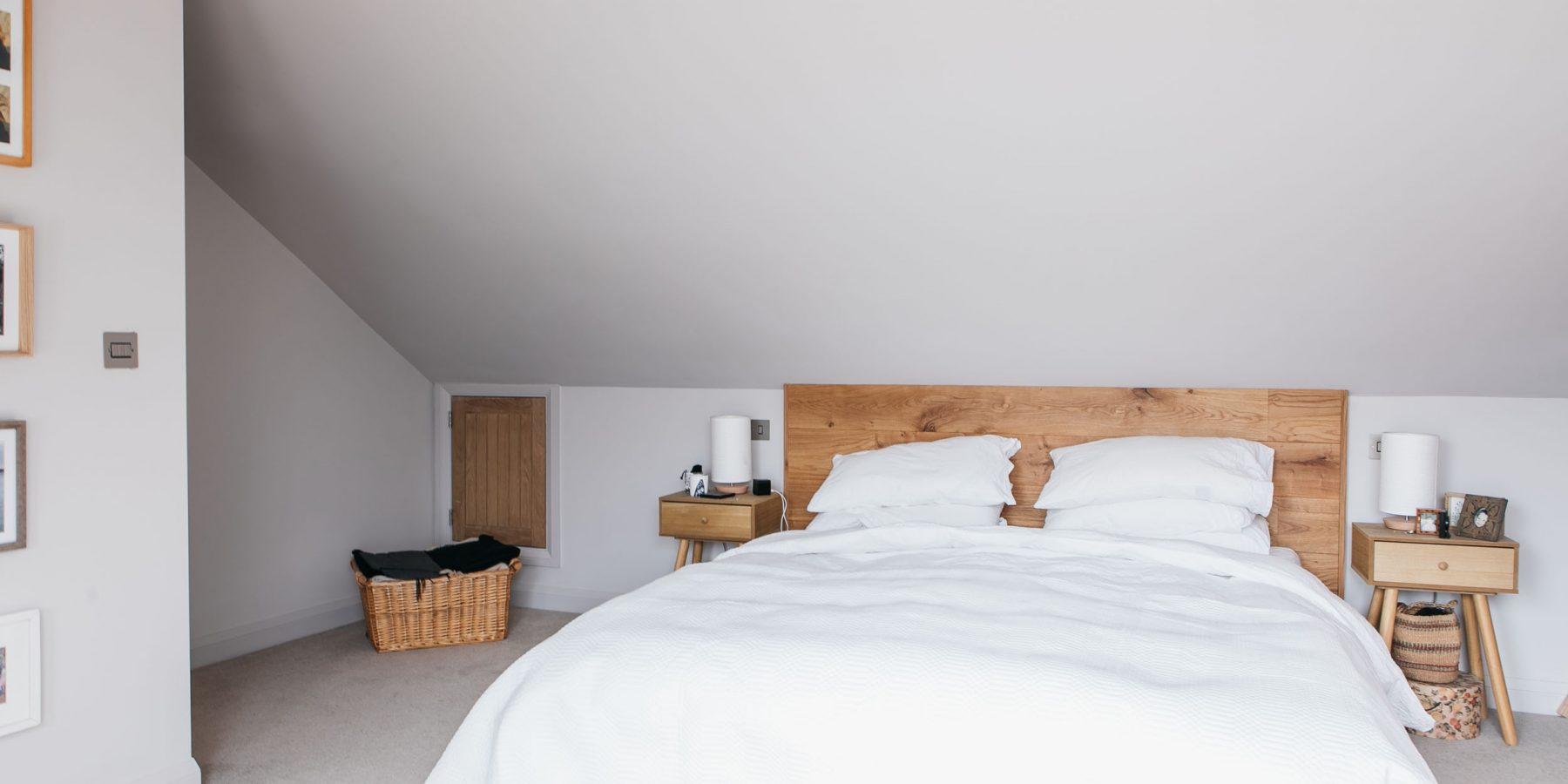 Thumbnail of http://White%20bed%20with%20wooden%20headboard