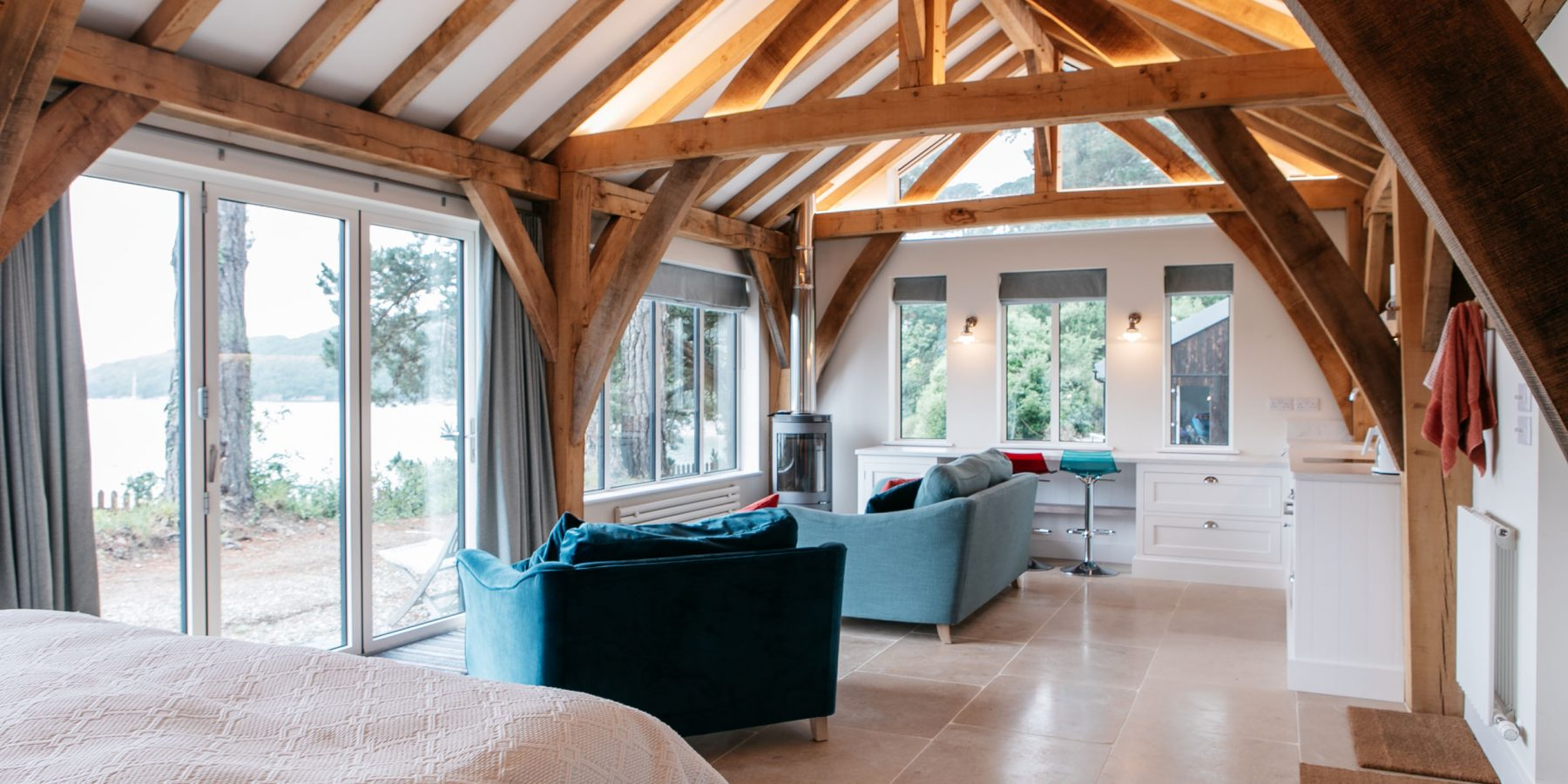 Thumbnail of http://Room%20with%20exposed%20wood%20beams%20and%20large%20windows